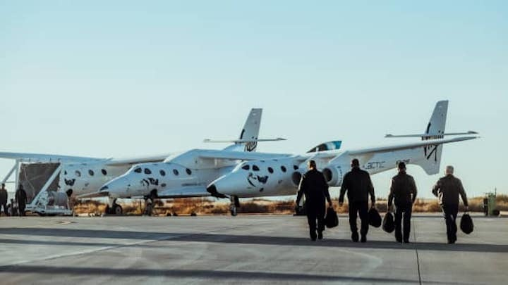 106810701-1607952051360-virgin-galactic-pilots-on-their-way-to-the-virgin-galactic-spaceflight-syste